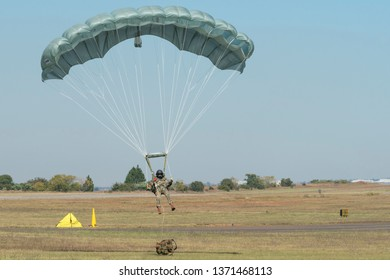 PRETORIA, SOUTH AFRICA-MAY 5 2018: Paratrooper with full kit about to land at the Swartkops Museum Airshow