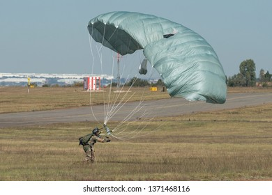 PRETORIA, SOUTH AFRICA-MAY 5 2018: Paratrooper with full kit landing at the Swartkops Museum Airshow