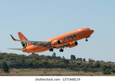 PRETORIA, SOUTH AFRICA-MAY 5 2018: Orange low cost airline from Mango Air  does an approach at the Swartkops Museum Airshow