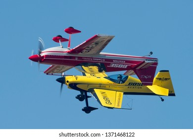 PRETORIA, SOUTH AFRICA-MAY 5 2018: Mark 'Sammy' Sampson  from Team Xtreme in a  XtremeAir XA41 looks at an inverted Mark Hensman in a MX2 at the Swartkops Museum Airshow