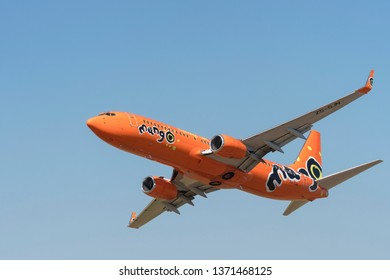 PRETORIA, SOUTH AFRICA-MAY 5 2018: Orange low cost airline from Mango Air  does a low level flypast at the Swartkops Museum Airshow