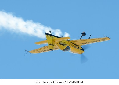 PRETORIA, SOUTH AFRICA-MAY 5 2018: Mark Sampson  from Team Xtreme demonstrates a yellow XtremeAir XA41 aerobatic aircraft inverted at the Swartkops Museum Airshow