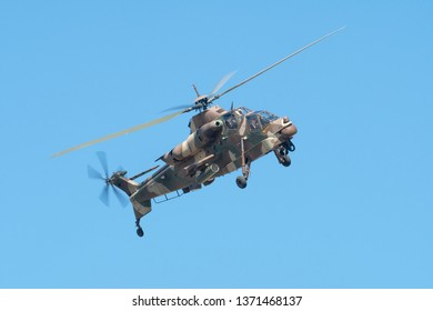 PRETORIA, SOUTH AFRICA-MAY 5 2018: SAAF Rooivalk attack helicopter flies past during mini air war at the Swartkops Museum Airshow