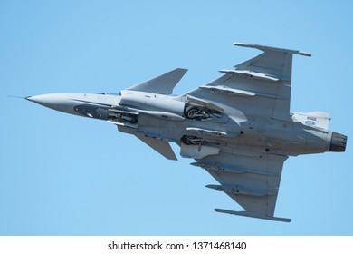 PRETORIA, SOUTH AFRICA-MAY 5 2018: A SAAF JAS-39 Grippen fighter jet retracting undercarriage during flypast at the Swartkops Museum Airshow