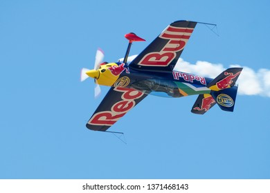 PRETORIA, SOUTH AFRICA-MAY 5 2018: Partrick Davidson demonstrates a Red Bull Racing Sback inverted at the Swartkops Museum Airshow