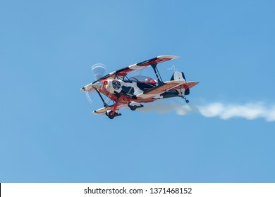 PRETORIA, SOUTH AFRICA-MAY 5 2018: An aircraft from the COWS Tailifts sponsored Pitts Special team flies past at the Swartkops Museum Airshow
