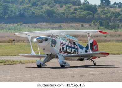 PRETORIA, SOUTH AFRICA-MAY 5 2018: An aircraft from the COWS Tailifts sponsored Pitts Special team taxing past at the Swartkops Museum Airshow