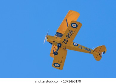 PRETORIA, SOUTH AFRICA-MAY 5 2018: Lt Col Jeff Earle in a Tiger Moth flying overhead at the Swartkops Museum Airshow