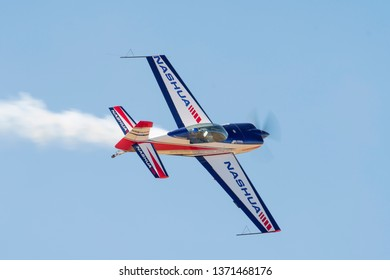 PRETORIA, SOUTH AFRICA-MAY 5 2018: Andrew Blackwood Murray in an Extra 300 with smoke on at the Swartkops Museum Airshow