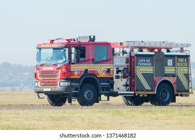 PRETORIA, SOUTH AFRICA-MAY 5 2018: A red fire engine from Tshwane City demonstrated at the Swartkops Museum Airshow