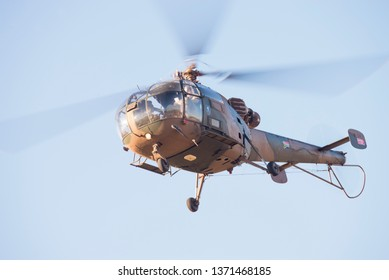 PRETORIA, SOUTH AFRICA-MAY 5 2018: A vintage SAAF  Alouette  III in camouflage colours hovers near the crowd line at the Swartkops Museum Airshow