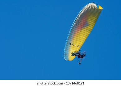 PRETORIA, SOUTH AFRICA-MAY 5 2018: A colourful powered paraglider flies past at the Swartkops Museum Airshow