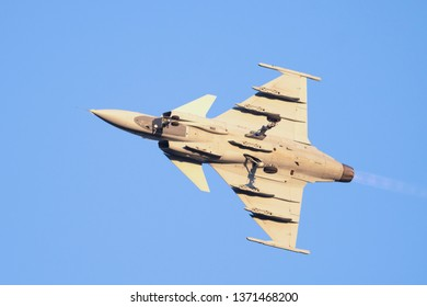 PRETORIA, SOUTH AFRICA-MAY 5 2018: A SAAF JAS-39 Grippen fighter jet with extended undercarriage and flames during flypast at the Swartkops Museum Airshow