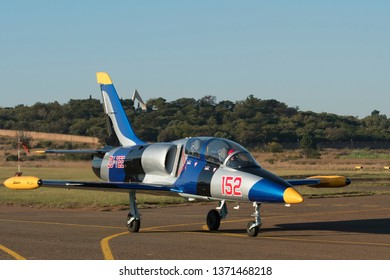 PRETORIA, SOUTH AFRICA-MAY 5 2018: Glen Warden in a L-39 Albatros taxing with monument in background at the Swartkops Museum Airshow
