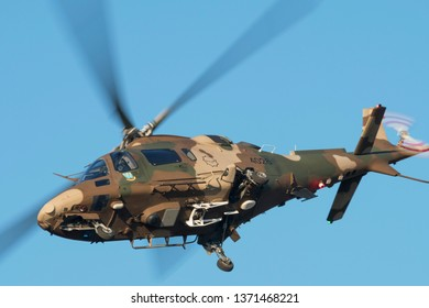 PRETORIA, SOUTH AFRICA-MAY 5 2018: Augusta A109 helicopter with wheels extended flies past at the Swartkops Museum Airshow