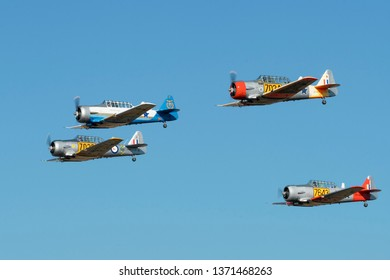 PRETORIA, SOUTH AFRICA-MAY 5 2018: Four ship formation flypast of restored Harvard AT-6 trainers at the Swartkops Museum Airshow
