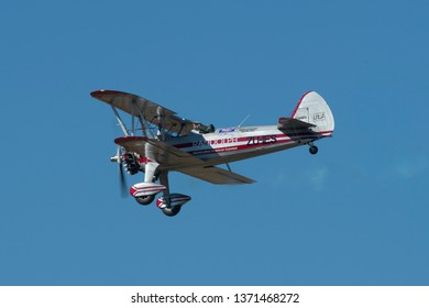 PRETORIA, SOUTH AFRICA-MAY 5 2018: Ivan vd Schaar demonstrates a slow fly past in a Boeing Stearman at the Swartkops Museum Airshow