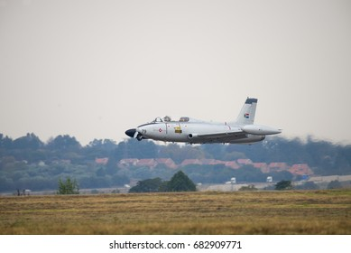 PRETORIA, SOUTH AFRICA-MAY 6 2017: An Impala trainer jet doing a low flypast at the Swartkops Museum Airshow
