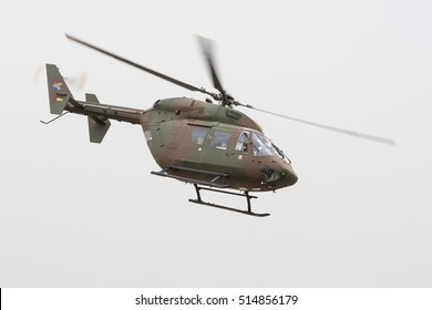 PRETORIA, SOUTH AFRICA-SEPTEMBER 17 2016: A MBB BK117 utility helicopter in camouflage colorsflies past at the African Air Defense show at AFB Waterkloof