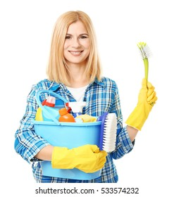 Pretty adult woman with cleaning supplies on white background
