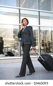 An pretty african american business woman travelling