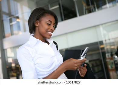 An pretty african american business woman checking her cell phone