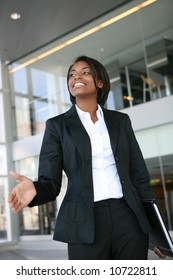 A pretty african american business woman offering a handshake