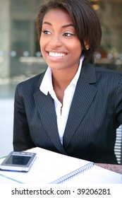 A pretty african american business woman at workplace