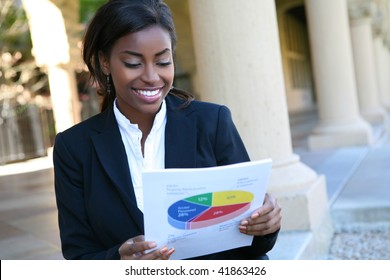 Pretty African American Business Woman  Holding Report
