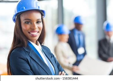 pretty african american female construction worker in office
