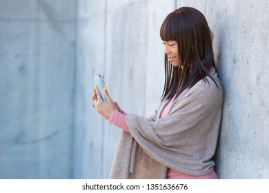 Pretty African American on texting on smart phone