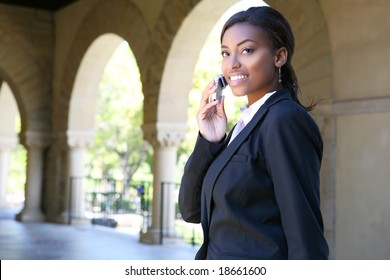 A pretty african american woman at college on phone