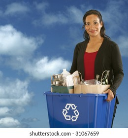 Pretty African American Woman holding a recyclables bin on a sky background