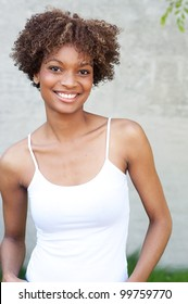 pretty African American woman standing outside
