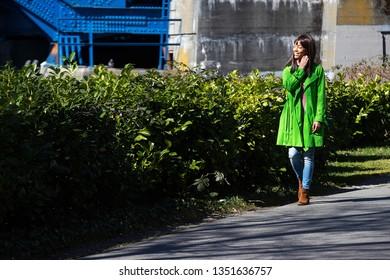 Pretty African American woman walking outside on trail
