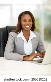 pretty african businesswoman using computer in office