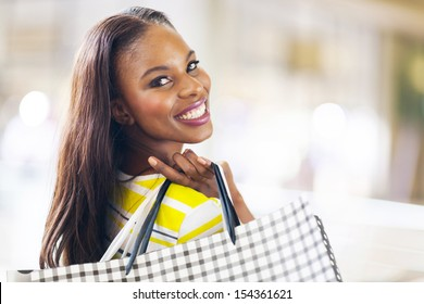 pretty african young lady shopping in mall