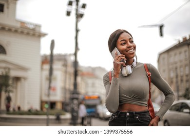 Pretty Afro woman  talking on a cellphone.