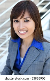A pretty asian business woman at office building