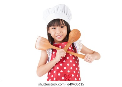 Pretty asian child holding cooking utensils isolated on white background