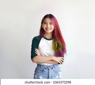 pretty asian femele smiling joyfully with colorful hair in dressed casually like hipster lifestyle, Independent fashion concept.