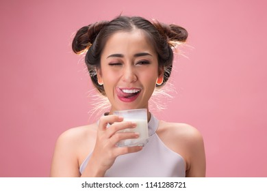 Pretty asian girl drinking milk with happiness