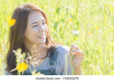 pretty asian girl outdoor,beautiful teenage model girl on the yellow flower field