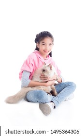 Pretty asian girl sitting on the floor and holding her cat with smiles over white background