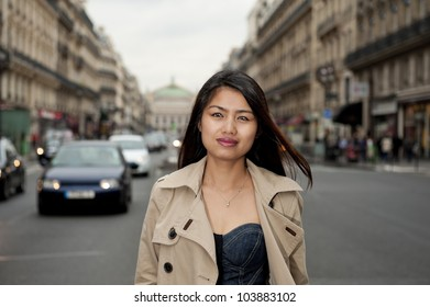 pretty asian girl walking in the streets of paris