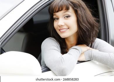 Pretty asian girl in a white car