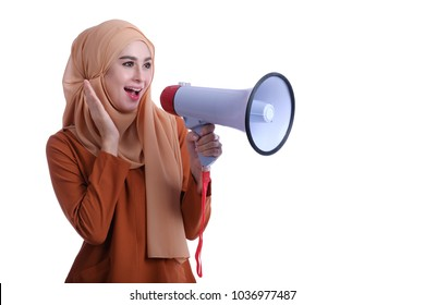 Pretty Asian muslim holding megaphone with expression face. Business conceptual or marketing concept