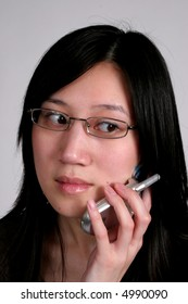 Pretty asian talking on a cell phone