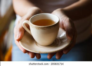 Pretty Asian woman drinking tea for health.