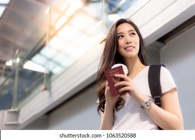 Pretty asian woman get holiday, charming beautiful woman designs going to beautiful place at foreign or oversea country. Attractive girl feel happy and relaxed. She wait for calling flight at airport